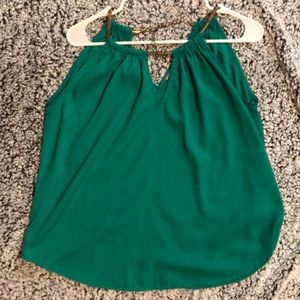 Tops - Green top. With gold chain
